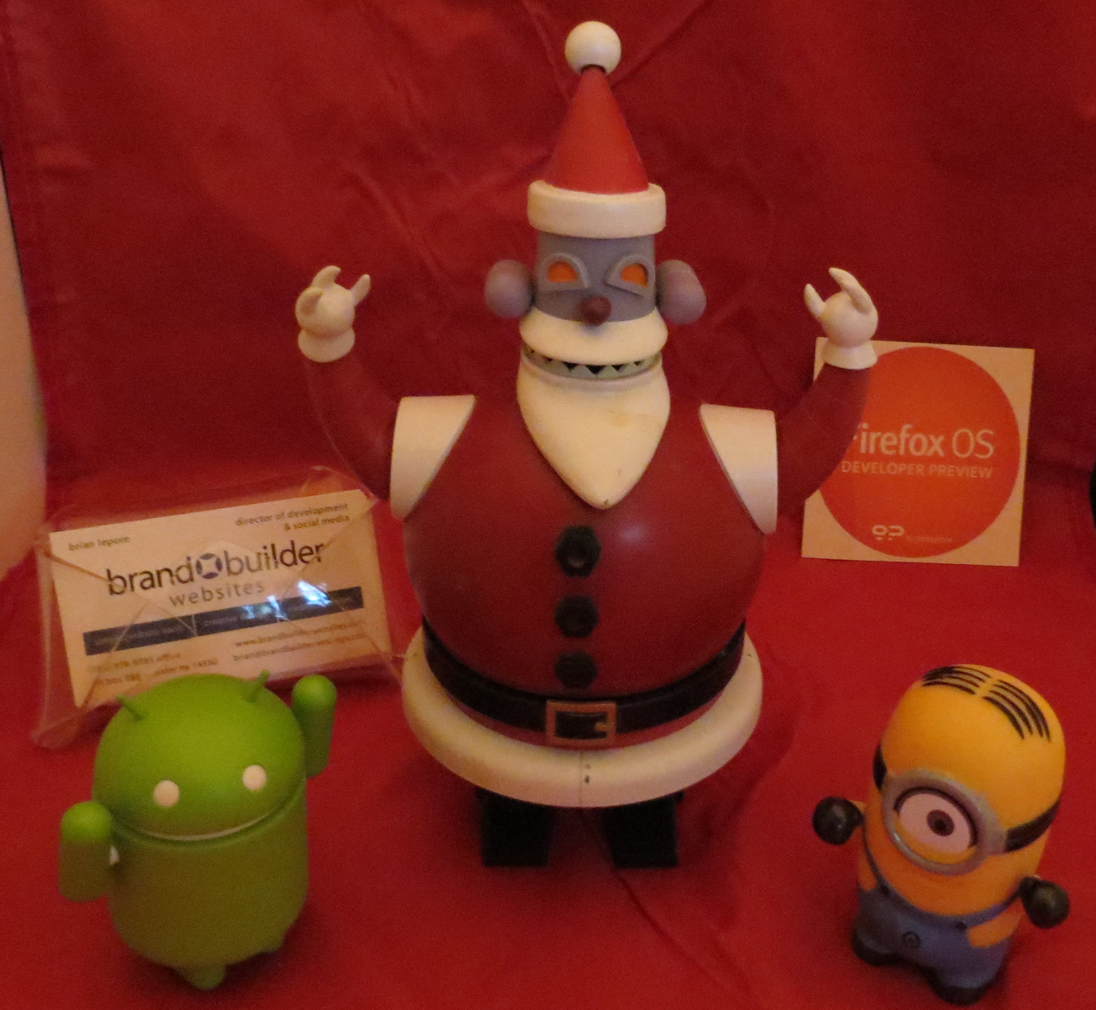 Robot Santa, Andy the Android, and Minion welcome Brand Builder Website's tech gift ideas.