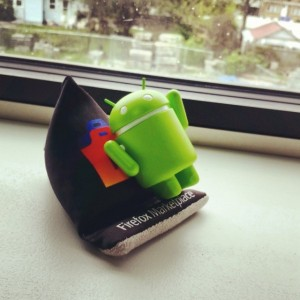 An Instagram photo of Android resting on Firefox OS in front of Windows.